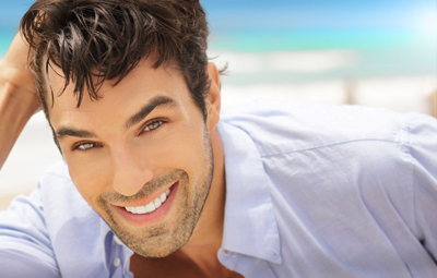 Smiling Man Satisfied with his Dental Whitening Treatment