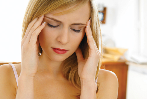 Woman Experiencing Excruciating Migraine Pains
